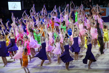 Kyiv, Ukraine - March 18, 2012: Dancing group of tournament participants perform during Gala Concert at Rhythmic Gymnastics Deriugina Cup