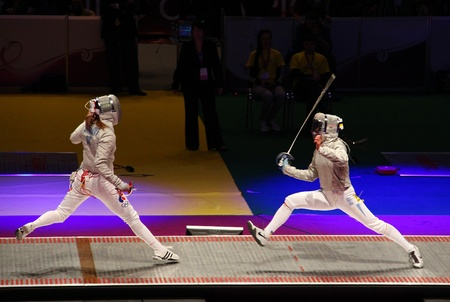 KYIV, UKRAINE - APRIL 13: Yuliya Gavrilova (Russia) fights against Olena Khomrova (Ukraine) during womens sabre team final match of the World  Fencing Championships on April 13, 2012 in Kyiv, Ukraine