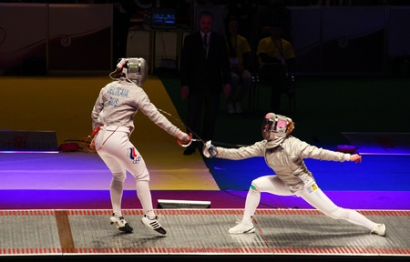 KYIV, UKRAINE - APRIL 13: Sofya Velikaia (Russia) fights against Olga Kharlan (Ukraine) during women's sabre team final match of the World Fencing Championships on April 13, 2012 in Kyiv, Ukraine