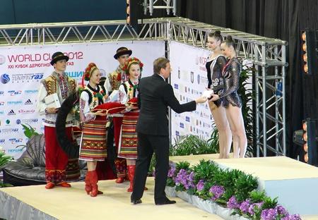 Kyiv, Ukraine - March 18, 2012: Alina Maksymenko and Anna Rizatdinova (Ukraine) get silver medals of Deriugina Cup (Rhythmic Gymnastics World Cup) Stock Photo - 13337684
