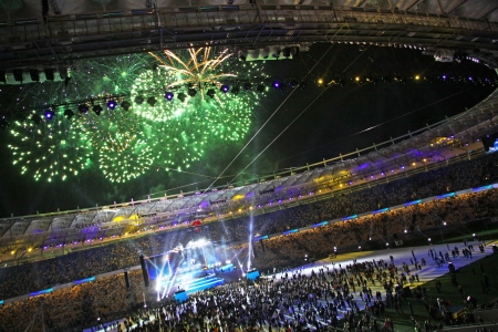Kyiv, Ukraine - October 8, 2011: Spectators watch fireworks at the end of opening ceremony of main Euro-2012 arena - Olympic stadium (NSC Olimpiysky)