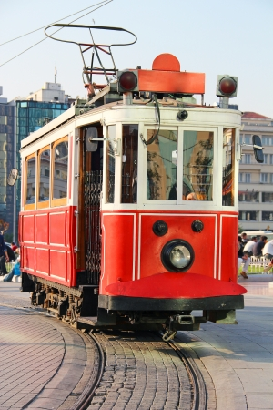 Red vintage tram on Taksim square in Istanbul, Turkey photo