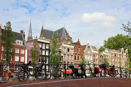 Amsterdam cityscape with bikes on the bridge, Netherlands