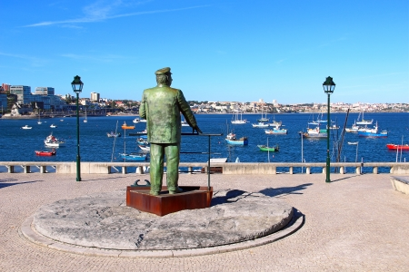 lisboa: The Statue of Dom Carlos I, King of Portugal, overlooking the harbor in Cascais, Portugal Stock Photo