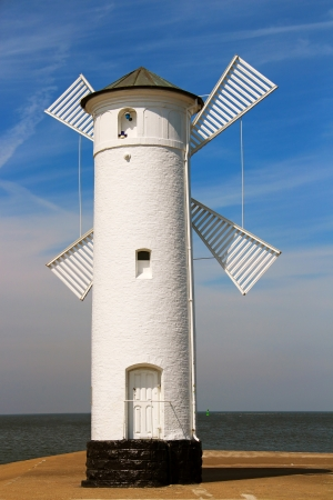 Lighthouse windmill in Swinoujscie, Baltic Sea, Poland photo