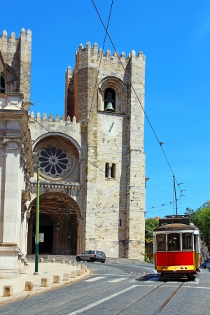 Lisbon Cathedral  Santa Maria Maior de Lisboa  and traditional old tram, Portugal photo