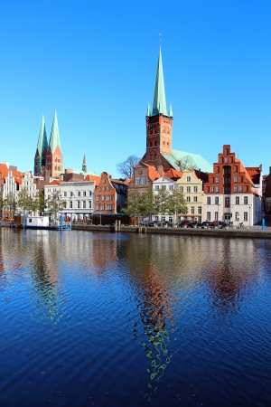 trave: Lubeck old town with Marienkirche  St  Mary s Church  and Petrikirche  St  Peter s Church  reflected in Trave river, Germany Stock Photo