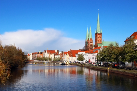 trave: Historic buildings reflected in Trave river, old town of Lubeck, Germany Stock Photo