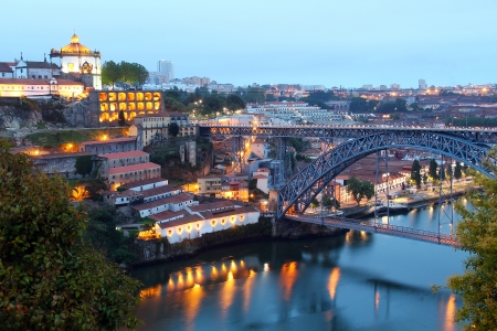Dom Luis Bridge  Ponte Luis I  and Vila Nova de Gaia with popular wine caves in the evening, Porto, Portugal
