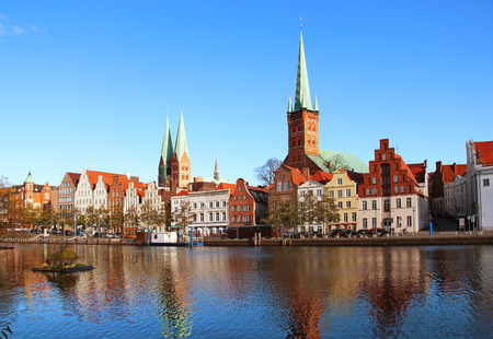Lubeck old town reflected in Trave river, Germany