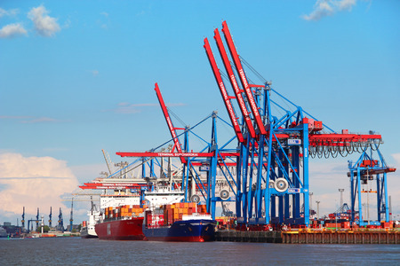 HAMBURG, GERMANY - JUNE 25, 2014: Port of Hamburg on the river Elbe, the largest port in Germany and one of the busiest ports in Europe