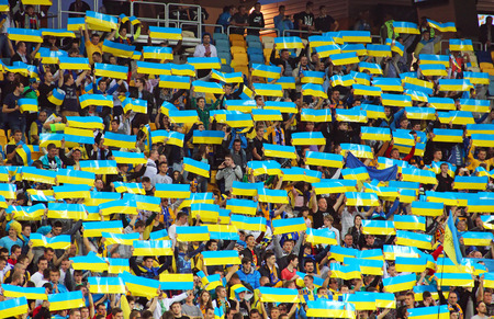 LVIV, UKRAINE - OCTOBER 12, 2014: Ukrainian fans support their team during the UEFA EURO 2016 Qualifying game between Ukraine and Macedonia on Lviv Arena