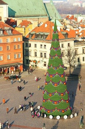 WARSAW, POLAND - DECEMBER 28, 2011: Christmas tree on the Castle Square (plac Zamkowy) in Warsaw old town, Poland