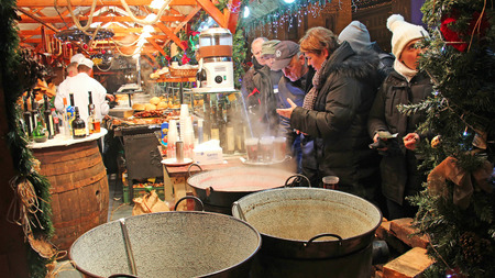 wine trade: BUDAPEST, HUNGARY - DECEMBER 31, 2012: People buy mulled wine at traditional Christmas market on Vorosmarty Square