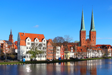 trave: Lubeck old town with Lubeck Cathedral (Lubecker Dom) reflected in Trave river, Germany Stock Photo