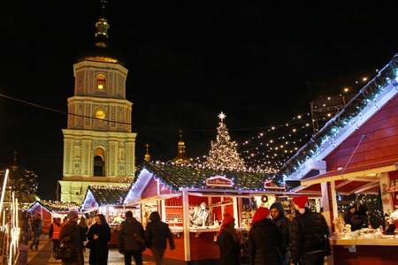 sofia: KYIV, UKRAINE - DECEMBER 25, 2014: St. Sophia Cathedral and Christmas market on Sophia Square in Kyiv