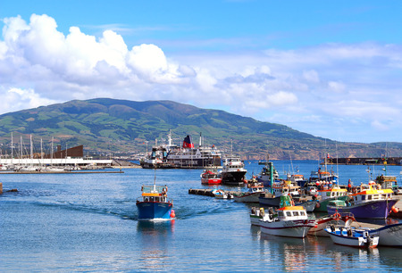 atlantic ocean: PONTA DELGADA, AZORES, PORTUGAL - SEPTEMBER 29, 2015: Fishing boats and ships in the harbor of Ponta Delgada on Sao Miguel island, Azores