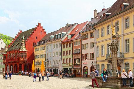 FREIBURG IM BREISGAU, GERMANY - MAY 5, 2013: Old buildings on Munsterplatz, the central square of Freiburg im Breisgau, Baden-Wurttemberg