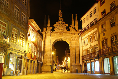 Arch of the New Gate Arco da Porta Nova and the entrance to the medieval wall of the city in Braga, Portugal