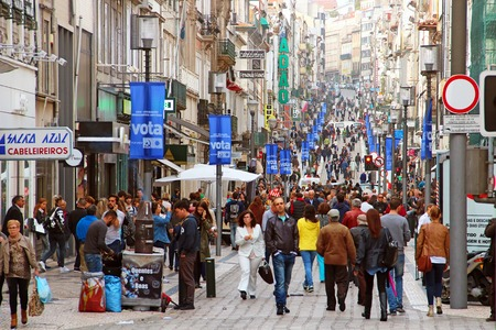 center city: PORTO, PORTUGAL - OCTOBER 5, 2015: People walking on the main shopping street Rua de Santa Catarina in the center of Porto Editorial