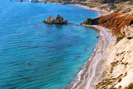 tou: Petra Tou Romiou beach with Aphrodites rock near Paphos, Cyprus Stock Photo