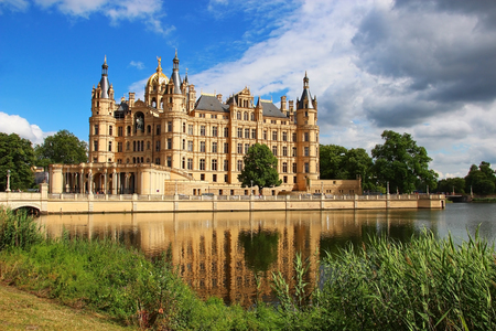 Schwerin Castle (Schweriner Schloss) reflected in the lake, Germany Editorial