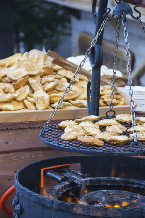 oscypek: Traditional polish smoked cheese oscypek grilled on Christmas market in Gdansk, Poland Stock Photo