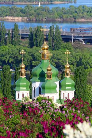 Vydubychi Monastery and lilac blossom in botanical garden in Kyiv, Ukraine