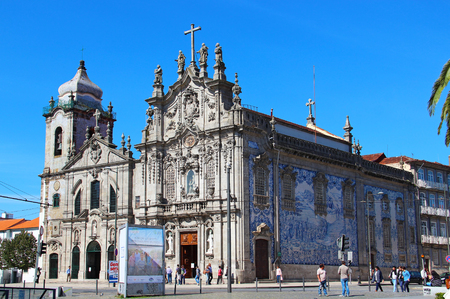 carmo: PORTO, PORTUGAL - OCTOBER 8, 2015: Carmelitas and Carmo Churches connected with each other and decorated with blue azulejos tiles