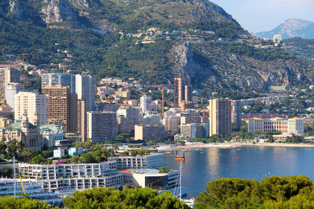 View of Monte-Carlo with casino, beach, and Beausoleil upper town Stock Photo