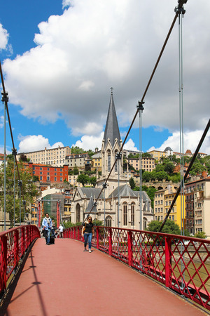 LYON, FRANCE - JUNE 17, 2016: St. Georges footbridge over Saone river and St. Georges church