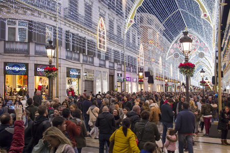 MALAGA, SPAIN - DECEMBER 9, 2017: Christmas decorations and light show in the center of Malaga (Calle Marques de Larios walking street)