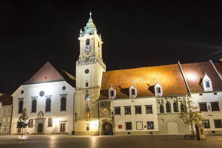 Old town hall (Stara radnica) and Jesuit church on the main square (Hlavne namestie) of Bratislava at night, Slovakia