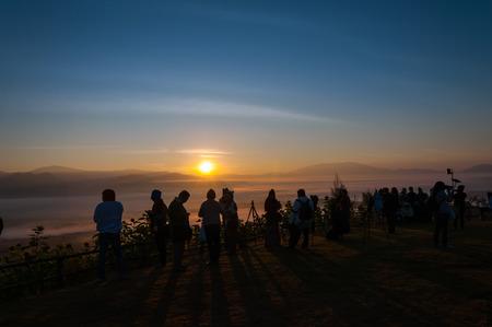 fog: PAI, MAE HONGSON, THAILAND - DECEMBER 29 : Unidentified tourists awaiting sunrise on December 29, 2010 at Yun Lai viewpoint, Pai, Mae Hongson, Thailand. The Yun Lai viewpoint is favorite place to see sunrise and sea fog for tourists.