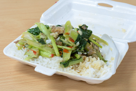 foam box: Thai food in the foam box on the table. Stock Photo