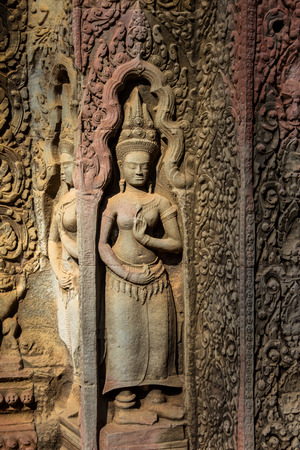 Apsaras an old Khmer art carvings on the wall in Ta Prohm Temple, Angkor, Cambodia