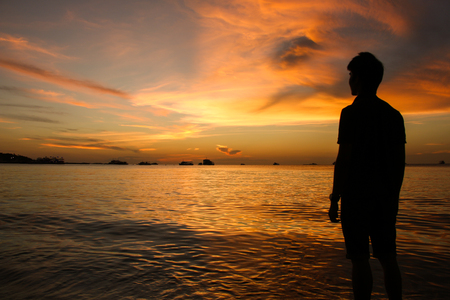 silently: silhouette of man at sunset on the Pattaya beach, Thailand