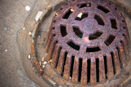 twist cap: The pipe cap is eroded. The rusted metal Stock Photo