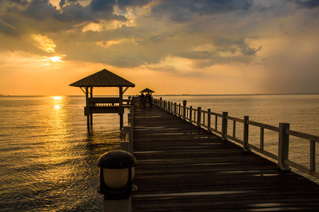 Landscape of Wooded bridge in the port between sunsets at Pattaya beach, Thailand Stock Photo
