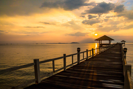 puget: Landscape of Wooded bridge in the port between sunsets at Pattaya beach, Thailand Stock Photo