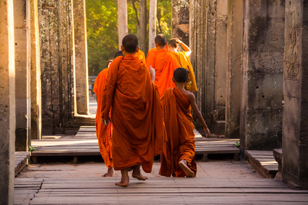 The monks in the ancient stone faces of Bayon temple, Angkor, Cambodia Banco de Imagens