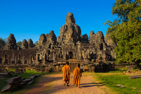 The monks in the ancient stone faces of Bayon temple, Angkor, Cambodia Stock Photo