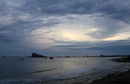 嵐の太平洋の夕日の空 写真素材