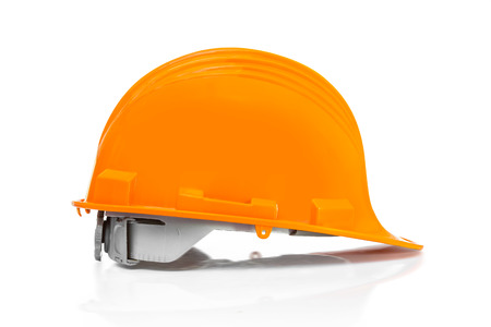head protection: An Orange helmet for protection and safe head who work on industry site made from plastic and polymer