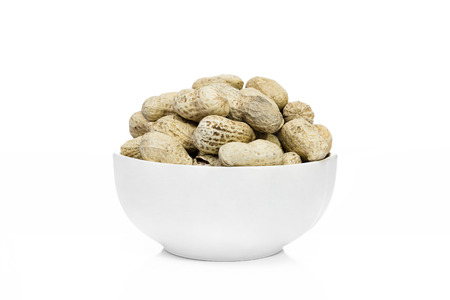 earthnut: Many Peanuts or groundnut drying in a white bowl