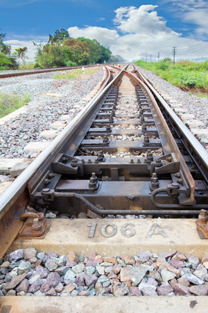 shunt: The railway was built to be used in the cargo hold is traveling to save money. And energy to drive And the convenience of commuters. The rails used are made of fine steel strength can get as much weight andshow crossway to train shunt switching to another Stock Photo