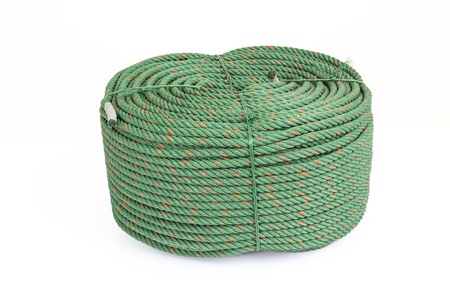 nylon string: Big roll of green nylon rope on white background and shadow so strong. Stock Photo