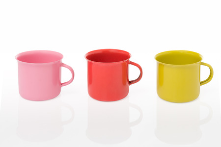 yellow tea pot: Three pieces of metal mug coating color include path on a white background