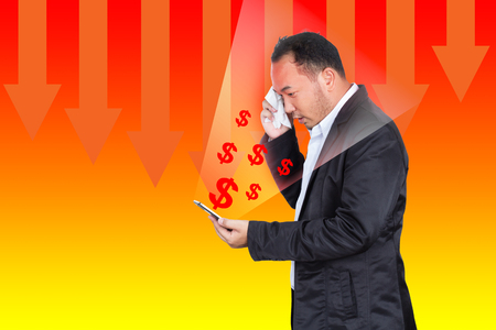 trading stocks: Businessman looking report about trading stocks show Earnings fall on mobile Stock Photo