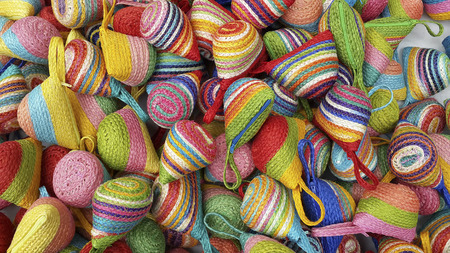 sisal: Wallet weave make from colorful of sisal, Beautiful product , bag Handmade in country from Thailand lay piled on the floor Stock Photo
